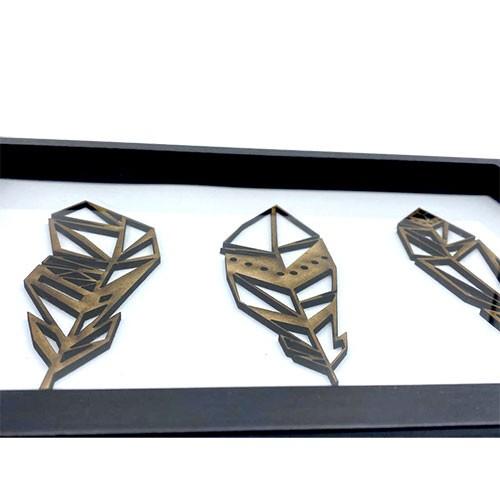 Federn 3D aus Holz im Rahmen